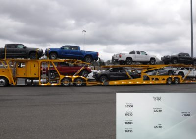 Boydstun 9106-48-EZ trailer loaded with 8 Toyota Tacoma trucks for transport