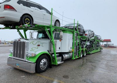 View of bonus deck above truck cab of Boydston auto transport trailer