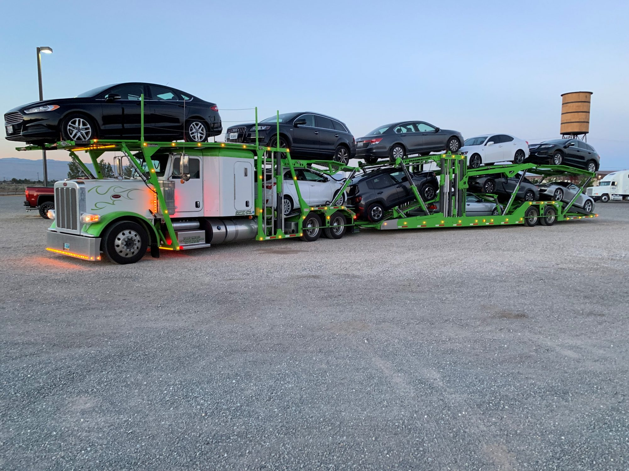Green Boydstun trailer loaded with 10 cars