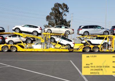 10 cars loaded onto Boydstun auto hauler trailer